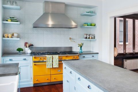A kitchen with a stove and a sink  Description automatically generated